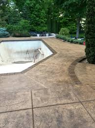 Stain Old Concrete Patio by Excellent Use Of Stained Concrete For This Pool Deck And Patio