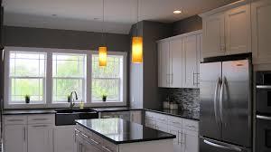 gray kitchen with white cabinets grey kitchen cabinets dark wood floors the darker brown cabinets