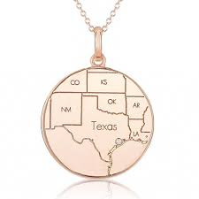 rose gold round map pendant with a diamond maps by a jaffe