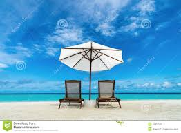 Beach Lounger Beach Lounger And Umbrella On Sand Beach Concept For Rest