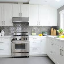 Classic Lines And A Simple Palette In This Renovated Kitchen - Grey subway tile backsplash