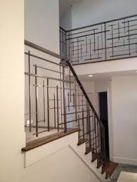 dark brown and chrome modern stair rails hall way pinterest