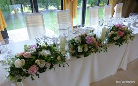 wedding flowers kent top table centrepiece with hurricane vases for wedding at flickr