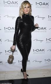 khloe kardashian sports slicked back wet hair and slim fit
