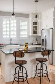 white kitchen cabinets with brown floors 54 white cabinet black countertop inspiring look cabinets