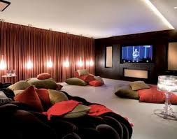 comfy seating with pillows on basement home theater idea