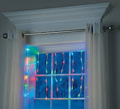 hanging christmas lights around windows small spaces how to decorate for christmas improvements blog