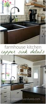 white kitchen cabinets with farm sink our copper sink