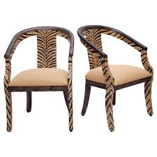 pair of tiger striped armchairs in coconut shell inlay for sale at