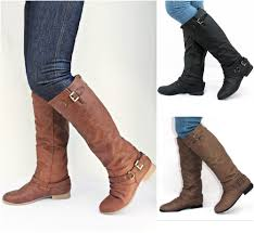 womens knee high boots australia a pair of light or brown leather boots on the hunt