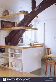 Loft Shelving by Shelves On Large Supporting Beam In Modern White Loft Kitchen With