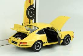 porsche museum 1973 porsche 911 carrera rs 2 7 yellow 1 18 welly porsche museum
