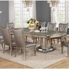 danette double pedestal dining table set in metallic platinum