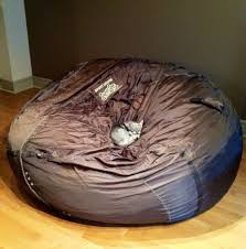 my miniature husky puppy napping in an over sized bean bag aww