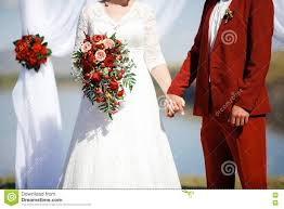 wedding in style marsala color bride and groom holding hands at