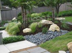 atlantic pebbles and cobbles with plum slate chippings and rockery