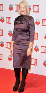 helen mirren in a ruched satin sheath dress with opaque tights