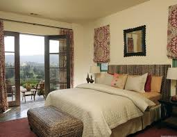 mediterranean guest bedroom with french doors by gary ahern