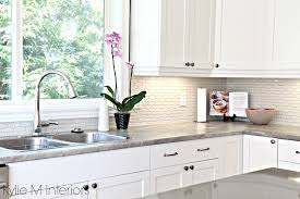 hexagon subway tile backsplash maple cabinets painted cloud white