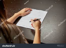 who writes white papers woman writing on white sheet paper stock photo 323601752 woman writing on a white sheet of paper signing a contract