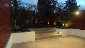 modern garden design night view garden cream smooth paving raised
