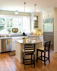 small white kitchen island this is a great kitchen would not change anything 2 smaller