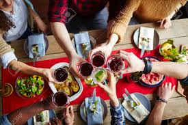 group friends toasting red wine dinner stock photo
