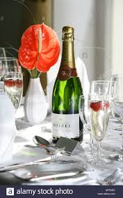 Table Setting Images by Champagne Bottle In Table Setting At Wedding Breakfast Stock Photo