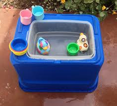 water table for 1 year old diy water table large plastic storage tub turned over cut hole