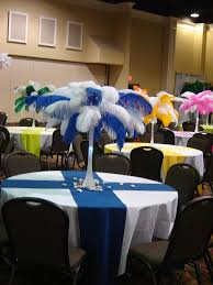 Not the centerpiece but alternating blue and green cloths across