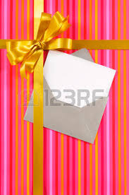 blue gift ribbon bow on candy stripe wrapping paper blank