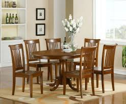 used dining room table and 6 chairs oak with set chair covers of