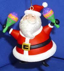 hallmark ornament feliz navidad 2009 santa claus maracas jose