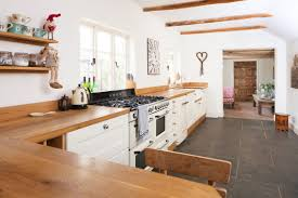 white shaker kitchen with solid wood worktops duck egg kitchens
