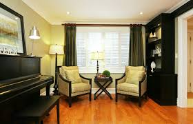 piano in living room jennifer brouwer design inc traditional family room toronto