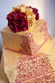 Red And Yellow Indian Wedding Cake Demers Banquet Hall