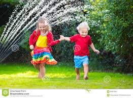 kids playing with garden sprinkler stock photo image 68361564