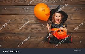 halloween background child funny child witch costume halloween fotka 483437512