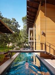 cost of a lap pool lap pool cost pool contemporary with bridge exterior rafter tails
