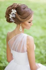 Hochsteckfrisurenen Lange Haare Halb Offen by Brautfrisur Dutt Mit Dekorativen Künstlichen Blumen Seitlich