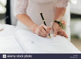 wedding signing signing marriage license or wedding contract stock photo