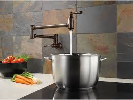decorating daltile backsplash with bronze pot filler faucet and