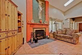 orange living room sandstone tile floors zillow digs zillow