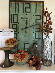 homedecor a la maison living and giving beautifully love the blend of the reclaimed wood pedestal the turquoise of the vintage clock and warmth of the fall colored florals and branches