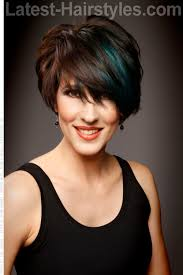 fun hairstyles for over 40 short asymmetric hair cut with layers and peek a boo color hair
