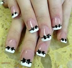 black and white nail polishes with black bowtie accents and white