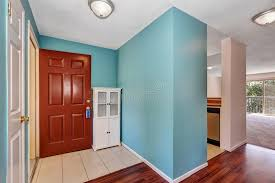 White Cabinets With Blue Walls Apartment Hallway Interior With Blue Walls Tile And Wood Flooring