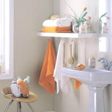 bathroom bathroom towel storage with orange and white towel