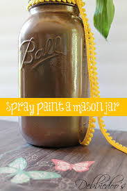 spray painting a mason jar with rust oleum spray paint debbiedoos