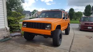orange jeep trimmed the fenders and bedlined the xj orange cherokeexj